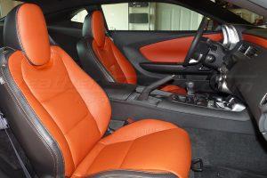Chevrolet Camaro leather upholstery kit installed - black and tangerine - front passenger seat
