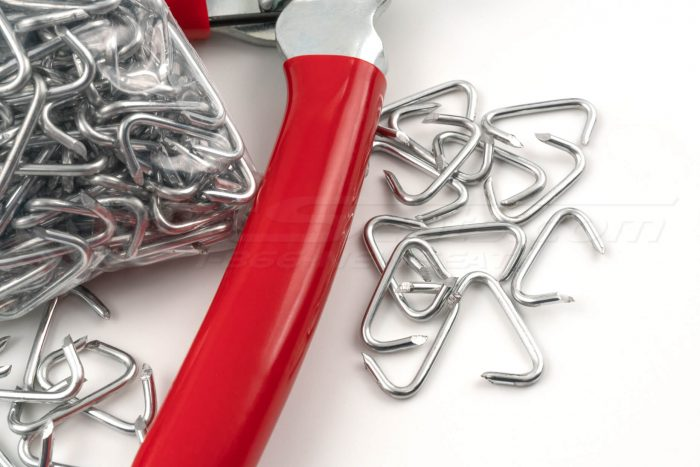Scattered hog-rings and red hog-ring plier handle