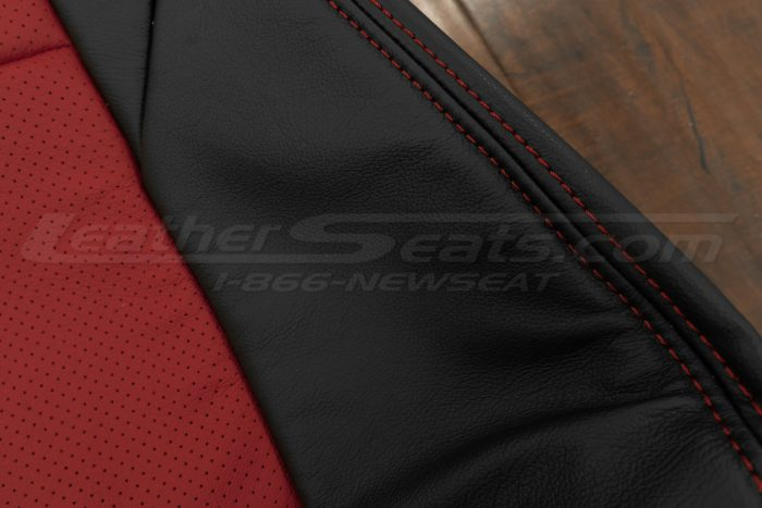 Red double-stitching and perforated body
